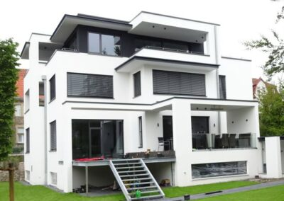 Flachdachabdichtung eines Wohnhausneubaues in Detmold mit Polystyrol Gefällewärmedämmung und Bauder Elastomerbitumenbahnen