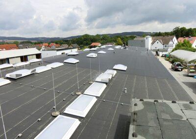 Flachdachsanierung mit Kunststoff-Dachbahnen Rhepanol fk